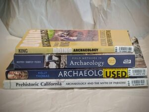 stack of archaeology books